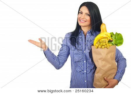 Woman With Groceries Making Presentation