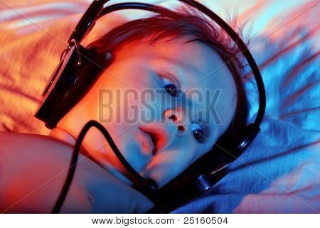 Small Baby Listening To Music