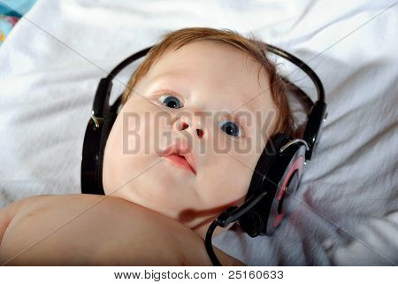 Portrait Of Beautiful Baby With Headphones