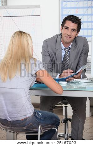 Man going through some work with a young female