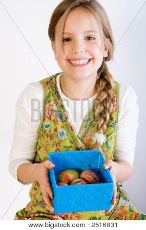 Young Girl Presenting A Box With Painted Eggs