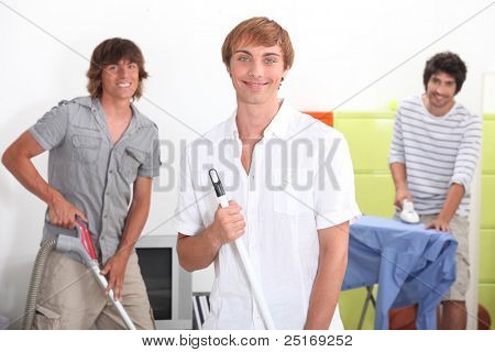 Young men doing household chores