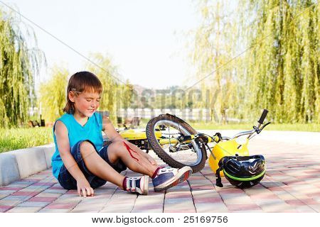 Unhappy kid who has fallen off the bike
