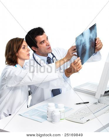 Smiling medical doctors with x-ray. Isolated over white background.