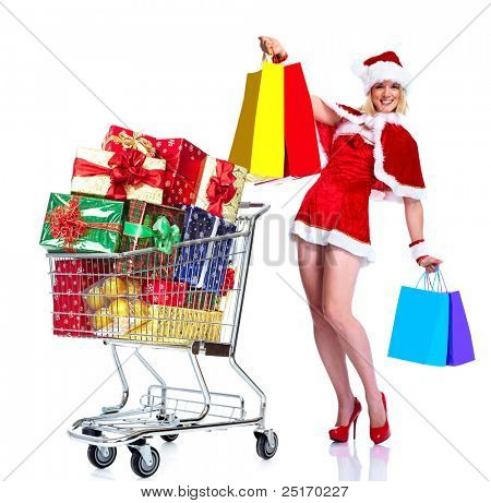 Sexy santa helper woman with a shopping cart. Christmas party. Isolated over white background.