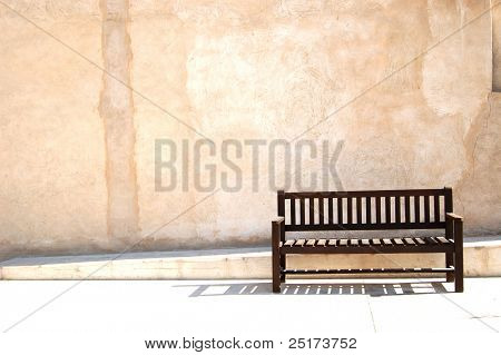 Bench on old town alley