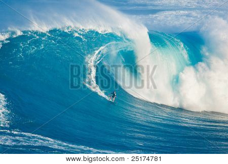 MAUI, HI - MARCH 13: Professional surfer Billy Kemper catches a giant wave at the legendary big wave surf break known as