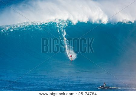 MAUI, HI - MARCH 13: Professional surfer Kiva Rivers catches a giant wave at the legendary big wave surf break known as