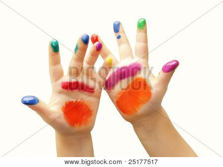 Child hands painted in colorful paints