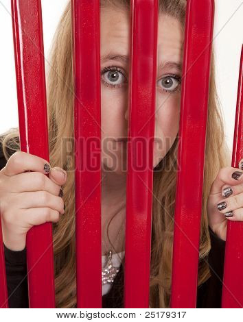 Girl Looking Through Bars