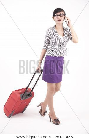Businesswoman With Suitcase Talking On The Phone