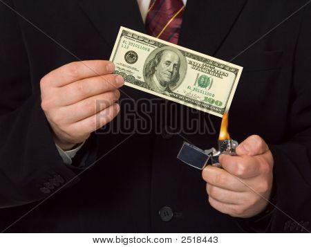 Man Burnning The Money
