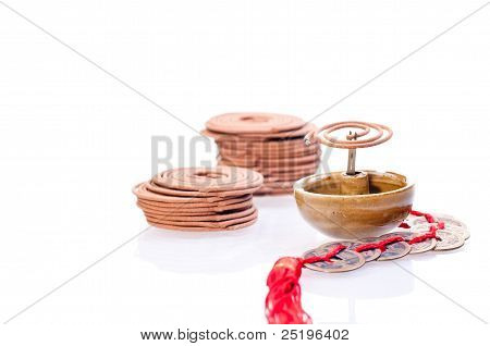 Incense Coil Burning With Old Chinese Coins