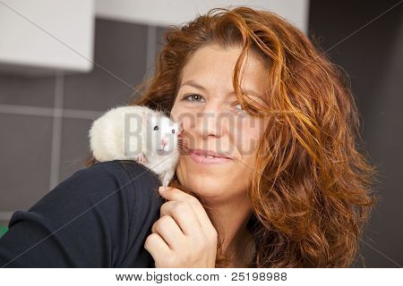 woman with rat on her shoulder