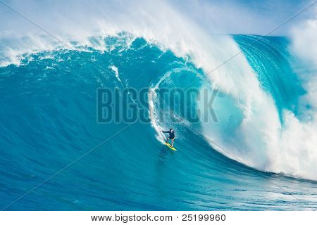 "MAUI, HI - MARCH 13: Professional surfer Carlos Burle rides a giant wave at the legendary big wave surf break ""Jaws"" during one the largest swells of the winter March 13, 2011 in Maui, HI."