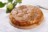 Apple Tarte Tatin - Classic French Upside-down Tart. Whole Fruit Pie On White Table. Rustic Style. poster