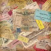 vintage travel background made of lots of old tickets, boarding passes, hotel reception cards and ot