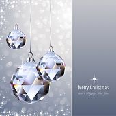 christmas background with crystal ornaments against a glittering background (background behind the p