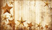 Christmas stars on a weathered country wooden background.
