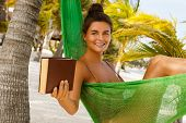 Happy And Beautiful Woman Lying In The Hammock And Reading Book poster