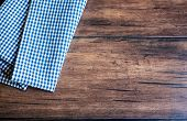 Checkered Blue Napkin On An Old Wooden Brown Background, Top View. Image With Copy Space. Kitchen Ta poster