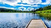 The Fishing Dock On Little Heffley Lake, A Small Fishing Lake At The Heffley-sun Peaks Road In The S poster
