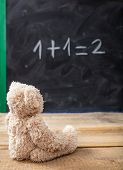 School Class Math. Teddy Bear Looking At A Simple Equation On A Blackboard.  One Plus One Equals Two poster