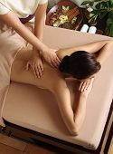 picture of deep-tissue  - Woman in a day spa getting a deep tissue massage therapy - JPG