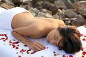 stock photo of nudist beach  - Beautiful woman getting massage  - JPG