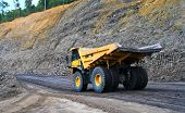image of earth-mover  - a panning shot a dump truck working on coal site - JPG