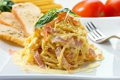 stock photo of guanciale  - Spaghetti carbonara on a white plate - JPG