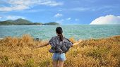 Portrait Of Young Woman Relaxing With Meadow, Sea, Mountain, Blue Sky And Cloud At Koh Sichang In Th poster