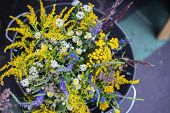 Wild Meadow Flowers Of Bright Colors On A Handmade Flower Fair. Bright Mix Bouquet Of Wild Meadow, F poster