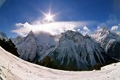 stock photo of snow capped mountains  - Winter in Dombai - JPG