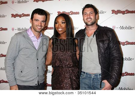 LOS ANGELES - FEB 26:  Tony Dovolani, Brandy Norwood, Maksim Chmerkovskiy arrives at the Rolling Stone Pre-Oscar Bash 2011 at W Hotel on February 26, 2011 in Hollywood, CA