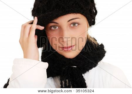 Beautiful teen girl with winter hat and scarf