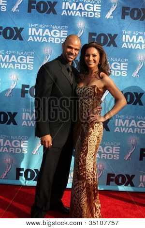 LOS ANGELES -  MARCH 4: Dondre T. Whitfield, Salli Richardson arriving at the 42nd NAACP Image Awards at Shrine Auditorium on March 4, 2011 in Los Angeles, CA