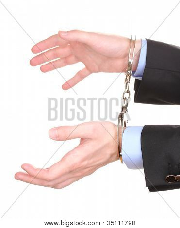 Businessman hands fettered with handcuffs isolated on white