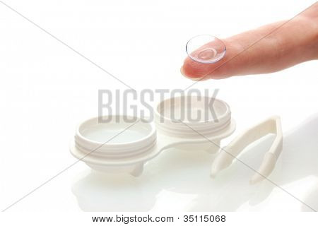 contact lenses in containers and tweezers, isolted on white