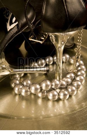 High Heel Shoes And A String Of Pearls On A Tray