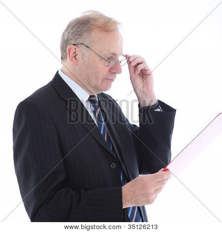 Serious Businessman Reading Report