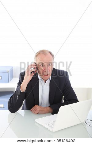 Businessman Reacting To News In Disbelief