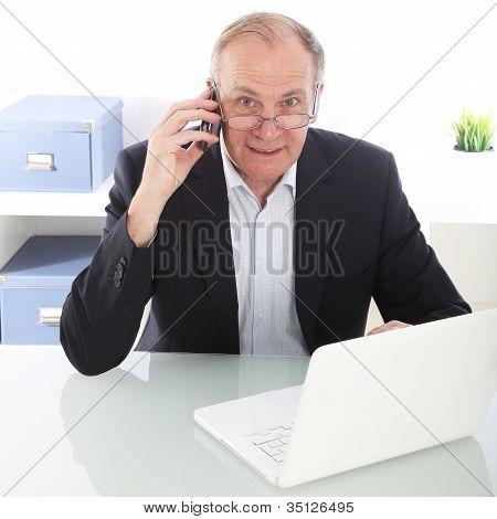 Hardworking Businessman On Mobile