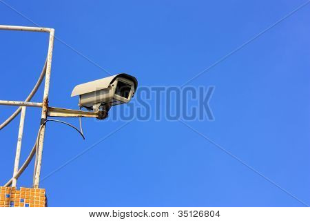 Security Cam Over Blue Sky With Large Copyspace