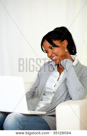 Lovely Young Woman Smiling And Looking To Laptop