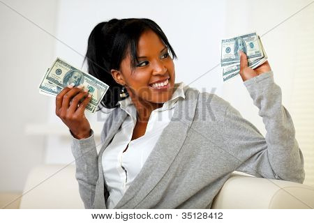 Charming Young Woman Holding Plenty Of Cash Money