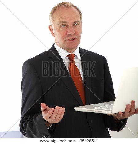 Persuasive Businessman Holding Laptop