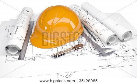 Orange helmet on architectural drawings