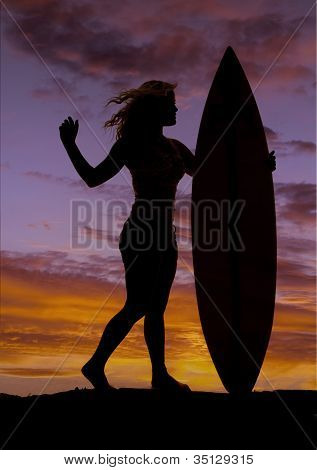 Woman Stand By Surfboard Sunset