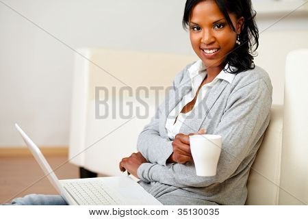 Young Woman With A Mug Looking To You